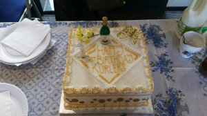 Kurlers celebrate with a cake made by a local baker